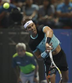 Rafael Nadal of Spain serve the ball to Novak Djokovic of Serbia, during exhibition tennis match in Bangkok, Thailand, Friday, Oct. 2, 2015. Djokovic beat Nadal 6-4, 6-2. (AP Photo/Sakchai Lalit)