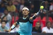"Rafael Nadal of Spain hits a return to Novak Djokovic of Serbia during their ""Back To Thailand - Nadal vs Djokovic"" friendly tennis match in Bangkok, Thailand, October 2, 2015. REUTERS/Athit Perawongmetha"