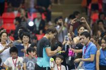 """Rafael Nadal of Spain signs autographs for fans after his """"Back To Thailand - Nadal vs Djokovic"""" friendly tennis match in Bangkok, Thailand, October 2, 2015. REUTERS/Athit Perawongmetha"""