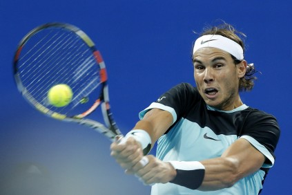 Rafael Nadal of Spain returns a shot against Vasek Pospisil of Canada during the Men's singles Second round match on day five of the 2015 China Open at the China National Tennis Centre on October 7, 2015 in Beijing, China. (Oct. 6, 2015 - Source: Lintao Zhang/Getty Images AsiaPac)