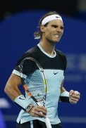 Rafael Nadal of Spain celebrates after winning his match against Vasek Pospisil of Canada during the Men's singles Second round match against Agnieszka Radwanska of Poland on day five of the 2015 China Open at the China National Tennis Centre on October 7, 2015 in Beijing, China. (Oct. 6, 2015 - Source: Lintao Zhang/Getty Images AsiaPac)