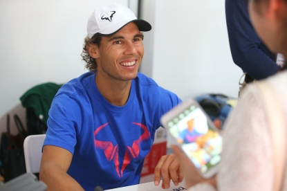 BEIJING, CHINA - OCTOBER 04: Rafael Nadal of Spain signs autographs on day two of the 2015 China Open at the China National Tennis Centre on on October 4, 2015 in Beijing, China. (Photo by Chris Hyde/Getty Images)