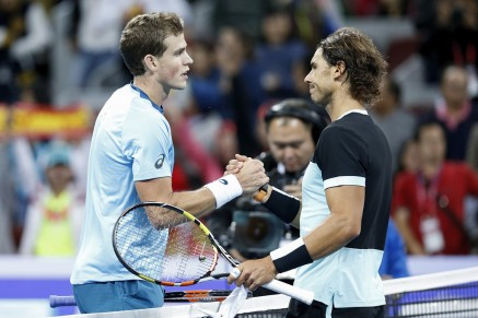 Rafael Nadal (R) of Spain shakes hands with Vasek Pospisil of Canada after winning the Men's singles Second round match against on day five of the 2015 China Open at the China National Tennis Centre on October 7, 2015 in Beijing, China. (Oct. 6, 2015 - Source: Lintao Zhang/Getty Images AsiaPac)