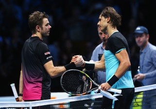 Rafael Nadal of Spain shakes hands with Stanislas Wawrinka of Switzerland after their men's singles match during day two of the Barclays ATP World Tour Finals at O2 Arena on November 16, 2015 in London, England. (Nov. 15, 2015 - Source: Clive Brunskill/Getty Images Europe)