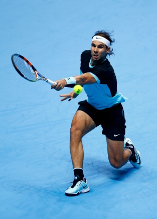 LONDON, ENGLAND - NOVEMBER 18: Rafael Nadal of Spain reaches for a backhand in his men's singles match against Andy Murray of Great Britain during day four of the Barclays ATP World Tour Finals at the O2 Arena on November 18, 2015 in London, England. (Photo by Julian Finney/Getty Images)
