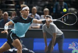 Rafael Nadal of Spain returns the ball to Kevin Anderson of South Africa during their third round match of the BNP Masters tennis tournament at the Paris Bercy Arena, in Paris, France, Thursday, Nov. 5, 2015. (AP Photo/Michel Euler)
