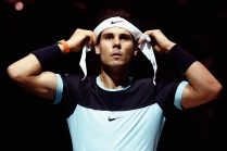 PARIS, FRANCE - NOVEMBER 05: Rafael Nadal of Spain adjusts his headband between games in his match against Kevin Anderson of South Africa during Day 4 of the BNP Paribas Masters held at AccorHotels Arena on November 5, 2015 in Paris, France. (Photo by Dean Mouhtaropoulos/Getty Images)