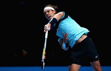 LONDON, ENGLAND - NOVEMBER 21: Rafael Nadal of Spain serves during his straight sets defeat by Novak Djokovic of Serbia during the men's singles semi final match on day seven of the Barclays ATP World Tour Finals at O2 Arena on November 21, 2015 in London, England. (Photo by Clive Brunskill/Getty Images)