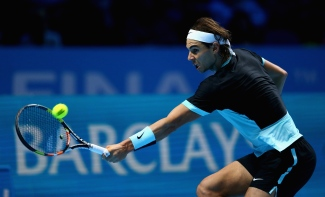 LONDON, ENGLAND - NOVEMBER 21: Rafael Nadal of Spain plays a backhand during his straight sets defeat by Novak Djokovic of Serbia during the men's singles semi final match on day seven of the Barclays ATP World Tour Finals at O2 Arena on November 21, 2015 in London, England. (Photo by Clive Brunskill/Getty Images)