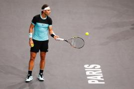 PARIS, FRANCE - NOVEMBER 06: Rafael Nadal of Spain looks on against Stan Wawrinka of Switzerland during Day 5 of the BNP Paribas Masters held at AccorHotels Arena on November 6, 2015 in Paris, France. (Photo by Dean Mouhtaropoulos/Getty Images)