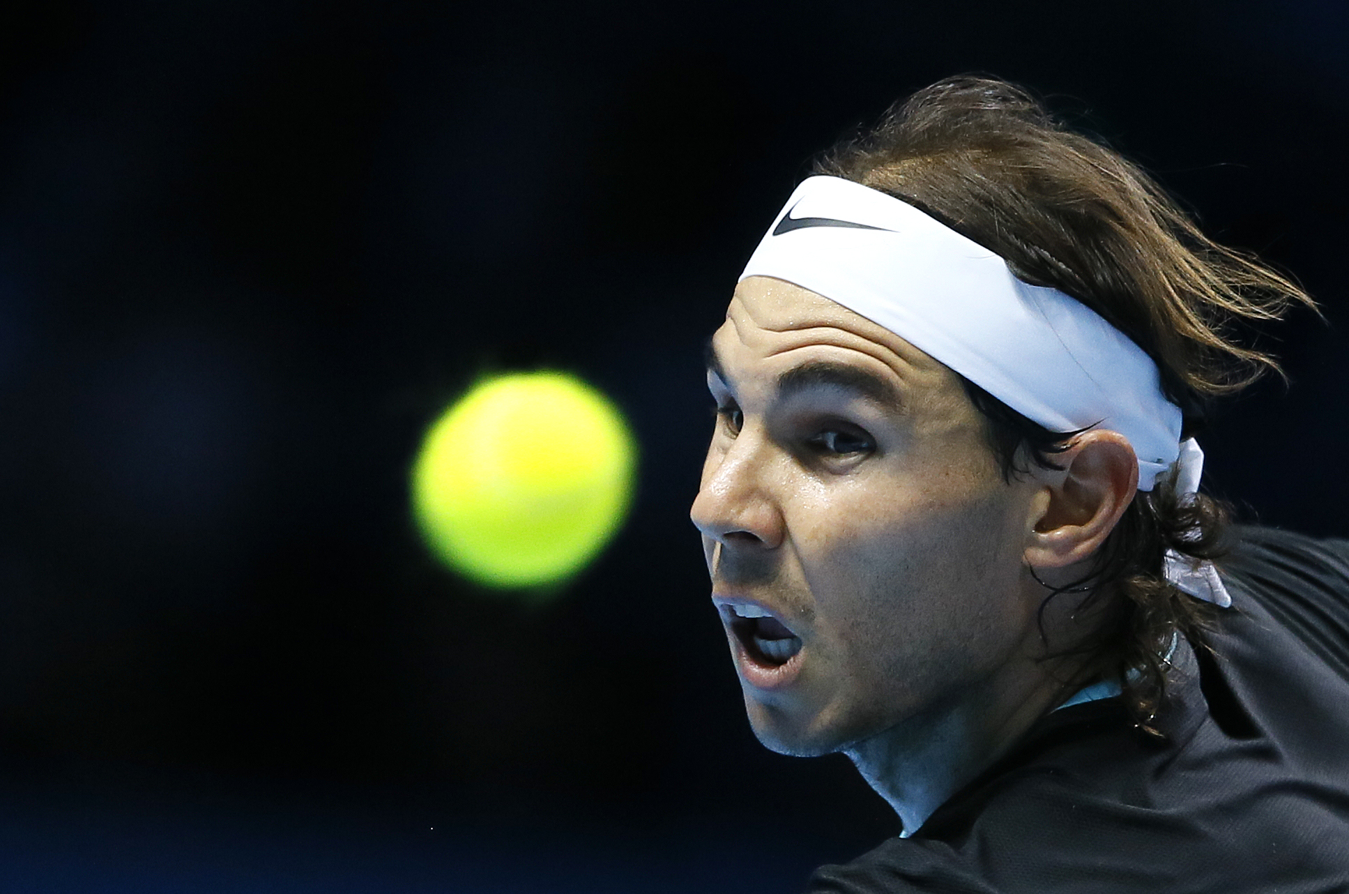 Rafael Nadal of Spain plays a return to Stan Wawrinka of Switzerland during their singles tennis match at the ATP World Tour Finals at the O2 Arena in ... - rafael-nadal-wins-opening-atp-world-tour-finals-match-against-stan-wawrinka-72