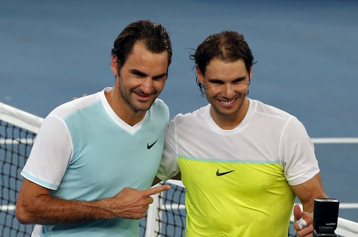 UAE Royals' Roger Federer (L) of Switzerland and Indian Aces' Rafael Nadal of Spain pose for pictures after their men's singles match in the International Premier Tennis League (IPTL) in New Delhi, India, December 12, 2015. REUTERS/Anindito Mukherjee