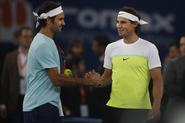 UAE Royals's Roger Federer, left and Indian Aces's Rafael Nadal greet each other during the International Premier Tennis League in New Delhi, India, Saturday, Dec. 12, 2015. (AP Photo /Tsering Topgyal)