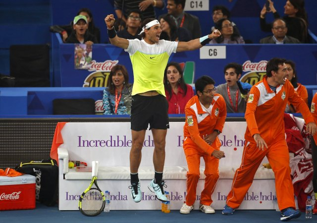 Indian Aces' Rafael Nadal (C) of Spain celebrates a point of his teammate Fabrice Santoro of France against UAE Royals' Goran Ivanisevic of Croatia during their men's singles match in the International Premier Tennis League (IPTL) in New Delhi, India, December 12, 2015. REUTERS/Anindito Mukherjee