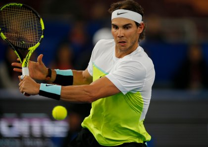 Rafael Nadal plays for Indian Aces against Edouard Roger Vasselin of Philippine Mavericks in the men's singles event of the International Premier Tennis League in New Delhi, India, Thursday, Dec. 10, 2015. (AP Photo/Tsering Topgyal)