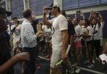 Spain's Rafael Nadal adjusts his cap during a tennis clinic in Makati, south of Manila, Philippines Sunday, Dec. 6, 2015. Nadal is in the country to promote his tennis academy and to compete in the International Premier Tennis League (IPTL). (AP Photo/Aaron Favila)
