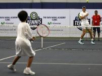 Spanish tennis player Rafael Nadal (2-R) plays tennis with a young boy during a 'tennis clinic' of his Rafa Nadal Academy with Filipino children in Manila, Philippines, 06 December 2015. Nadal is in Manila with other current and former international male and female tennis aces to compete in the International Premier Tennis League (IPTL). (Tenis, Filipinas) EFE/EPA/FRANCIS R. MALASIG