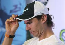 Spain's Rafael Nadal adjusts his cap as he answers questions before a tennis clinic in Makati, south of Manila, Philippines Sunday, Dec. 6, 2015. Nadal is in the country to promote his tennis academy and to compete in the International Premier Tennis League (IPTL). (AP Photo/Aaron Favila)