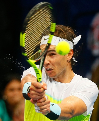 Spain's Rafael Nadal of the Indian Aces returns a shot against Czech Republic's Tomas Berdych of the UAE Royals during the men's singles in the 2015 International Premier Tennis League Monday, Dec. 7, 2015 at the Mall of Asia Arena in suburban Pasay city, south of Manila, Philippines. Nadal won over Berdych 6-5. (AP Photo/Bullit Marquez)