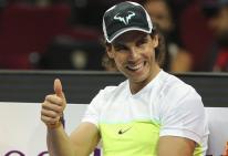 El tenista español Rafael Nadal, del Micromax Indian Aces, sonríe antes de disputar un partido de la segunda ronda de la Liga Asiática IPTL que se disputa en Manila (Filipinas), hoy, 7 de diciembre de 3015. En esta liga compiten cinco equipos mixtos integrados por tenistas tanto profesionales como retirados. EFE/Mark R. Cristino
