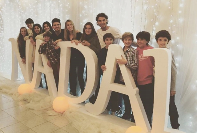 Rafael Nadal poses with sister Maria Isabel and cousins