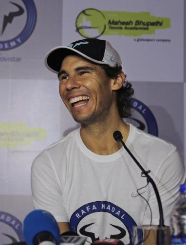 Spain's Rafael Nadal laughs during a press conference at a promotional event in New Delhi, India, Thursday, Dec. 10, 2015. Nadal, who plays for Indian Aces in the International Professional Tennis League (IPTL), is in India to play a leg of the league. (AP Photo/Altaf Qadri)