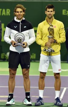 Novak Djokovic of Serbia (R) poses with the trophy after winning the final match against Rafael Nadal of Spain (L) during the Qatar ATP Open Tennis tournament at the Khalifa Tennis Squash Complex in Doha, Qatar, 09 January 2016. (España, Tenis) EFE/EP