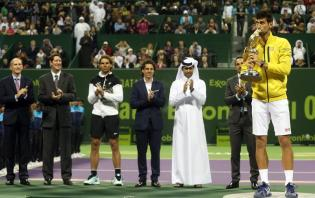 Novak Djokovic (R) of Serbia poses with the trophy after winning the final match against Rafael Nadal of Spain during the Qatar ATP Open Tennis tournament at the Khalifa Tennis Squash Complex in Doha, Qatar, 09 January 2016. (España, Tenis) EFE/EPA