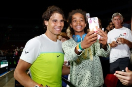 SYDNEY, AUSTRALIA - JANUARY 11: Rafael Nadalinteracts and takes has his photo taken with fans after the FAST4Tennis exhibition doubles match between Rafael Nadal and Gael Monfils of The World Team and Lleyton Hewitt and Nick Kyrgios of Australia Team at Allphones Arena on January 11, 2016 in Sydney, Australia. (Photo by Zak Kaczmarek/Getty Images)