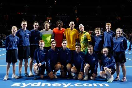 SYDNEY, AUSTRALIA - JANUARY 11: Rafael Nadal, Gael Monfils, Nick Kyrgios and Lleyton Hewitt pose with ball boys and ball girls after the FAST4Tennis exhibition doubles match between Rafael Nadal and Gael Monfils of The World Team and Lleyton Hewitt and Nick Kyrgios of Australia Team at Allphones Arena on January 11, 2016 in Sydney, Australia. (Photo by Zak Kaczmarek/Getty Images)