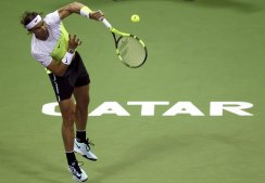 Rafael Nadal of Spain serves to Andrey Kuznetsov of Russia during their Qatar Open men's single tennis match in Doha, Qatar January 7, 2016. REUTERS/Ibraheem Al Omari