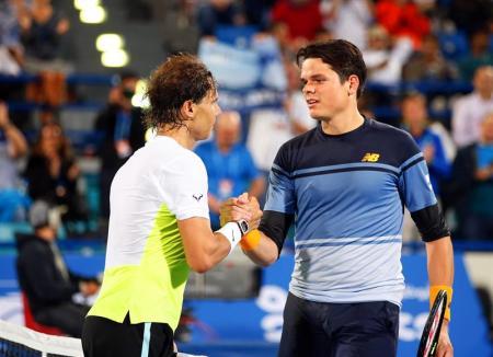 Spain's Rafael Nadal (L) is congratulated by Milos Raonic (R) of Canada after winning their final match of the Mubadala World Tennis Championship in Abu Dhabi, United Arab Emirates, 02 January 2016. (Tenis) EFE/EPA/ALI HAIDER