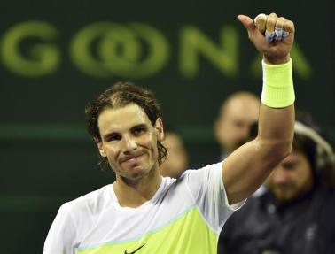 El tenista español Rafael Nadal celebra su victoria ante el holandés Robin Haase durante la segunda ronda del torneo de tenis de Doha, Catar hoy 6 de enero de 2016. EFE/Stringer
