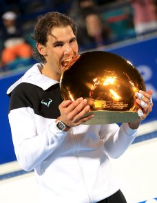 Rafael Nadal of Spain celebrates after winning the Mubadala World Tennis Championship in Abu Dhabi, January 2, 2016. REUTERS/Stringer EDITORIAL USE ONLY. NO RESALES. NO ARCHIVE