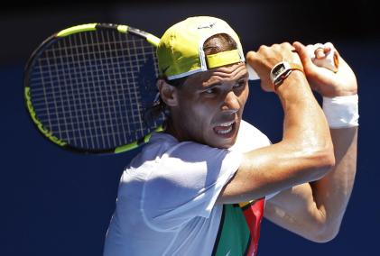 Rafael Nadal of Spain follows through on a shot during a practice session, ahead of the Australian Open tennis championships in Melbourne, Australia, Sunday, Jan. 17, 2016.(AP Photo/Vincent Thian)