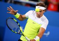 Rafael Nadal in action against Milos Raonic in Abu Dhabi final