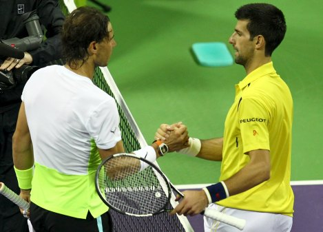Novak Djokovic of Serbia (R) shakes hands with Rafael Nadal of Spain after their Qatar Open men's single tennis final match in Doha, Qatar January 9, 2016. REUTERS/Ibraheem Al Omari