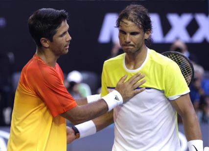 Rafael Nadal, right, of Spain is consoled by compatriot Fernando Verdasco after his first round loss to Verdasco at the Australian Open tennis championships in Melbourne, Australia, Tuesday, Jan. 19, 2016.(AP Photo/Mark Baker)