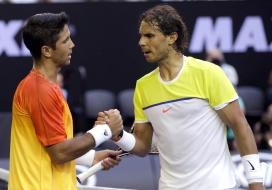 Rafael Nadal, right, of Spain congratulates compatriot Fernando Verdasco after their first round match at the Australian Open tennis championships in Melbourne, Australia, Tuesday, Jan. 19, 2016.(AP Photo/Mark Baker)