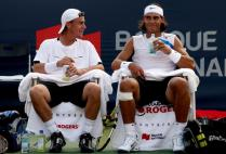 MONTREAL - AUGUST 07: Lleyton Hewitt of Australia and Rafael Nadal of Spain (R) laugh together between games Philip Bester and Pierre-Ludovic Duclos of Canada during the Coupe Rogers August 7, 2007 at Stade Uniprix in Montreal, Quebec, Canada. (Photo by Matthew Stockman/Getty Images)