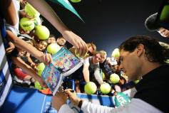 Spain's Rafael Nadal signs autographs after defeating Milos Raonic of Canada in their final match of the Mubadala World Tennis Championship in Abu Dhabi, United Arab Emirates, 02 January 2016. (Tenis) EFE/EPA/ALI HAIDER