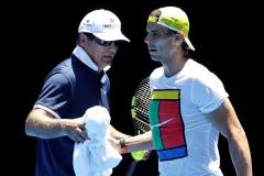 Rafael Nadal of Spain takes a towel from his Coach Toni Nadal during a practice session ahead of the Australian Open tennis tournament at Melbourne Park, in Melbourne, Australia, 17 January 2016. The Australian Open tennis tournament runs from 18 to 31 January 2016. (España, Tenis) EFE/EPA/MAST IRHAM