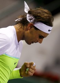 Rafael Nadal of Spain reacts during his Qatar Open men's single tennis match against Pablo Carreno Busta of Spain in Doha, Qatar, January 5, 2016. REUTERS/Ibraheem Al Omari