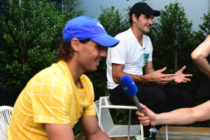 Roger Federer and Rafael Nadal conduct simultaneous TV interviews, 16 January 2016. - Ben Solomon/Tennis Australia