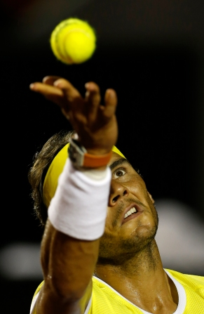 Rafael Nadal of Spain, serves to Pablo Carreno of Spain, at the Rio Open tennis tournament, in Rio de Janeiro, Brazil, Tuesday, Feb. 16, 2016. (AP Photo/Silvia Izquierdo)