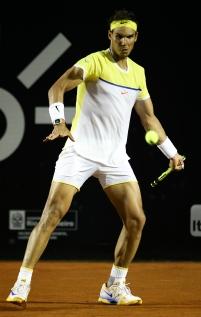 RIO DE JANEIRO, BRAZIL - FEBRUARY 18: Rafael Nadal of Spain returns a shot to Nicolas Almagro of Spain during the Rio Open at Jockey Club Brasileiro on February 18, 2016 in Rio de Janeiro, Brazil. (Photo by Buda Mendes/Getty Images)