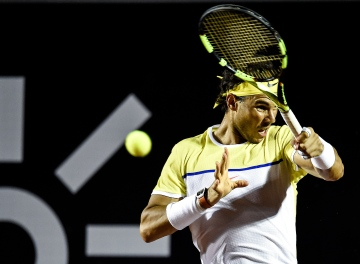 RIO DE JANEIRO, BRAZIL - FEBRUARY 16: Rafael Nadal of Spain returns a shot to Pablo Carreno Busta of Spain during the Rio Open at Jockey Club Brasileiro on February 16, 2016 in Rio de Janeiro, Brazil. (Photo by Buda Mendes/Getty Images)