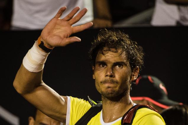 Rafael Nadal of Spain reacts to crowd after losing against Pablo Cuevas of Uruguay in the men's singles semi-final of the 2016 Rio Open tennis tournament in Rio de Janeiro, Brazil, on Februrary 21, 2016. (AFP Photo/YASUYOSHI CHIBA)