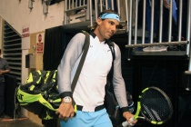 SAN JUAN, PUERTO RICO - MARCH 21: Rafael Nadal makes the entrance to Exhibition Match between Rafael Nadal vs Victor Estrella at Coliseo Jose M. Agrelot on March 21, 2016 in San Juan, Puerto Rico. (Photo by GV Cruz/WireImage)