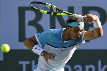 Rafael Nadal, of Spain, returns to Fernando Verdasco, of Spain, during the BNP Paribas Open tennis tournament, Tuesday, March 15, 2016, in Indian Wells, Calif. (AP Photo/Mark J. Terrill)